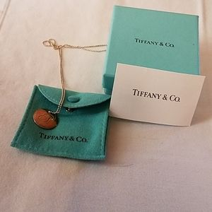 """Tiffany &Co necklace  with cursive """"S"""" on it."""
